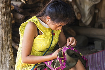 Hmong woman making embroideries, Na Aouan Village, Luang Prabang, Laos