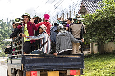 People riding in the back of a truck, Phonsavan, Xiangkhouang, Laos
