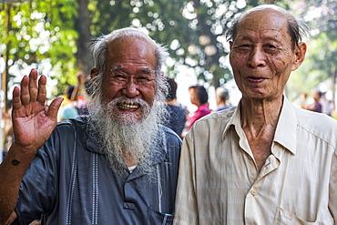 Pose of senior men smiling and waving for the camera, Hanoi, Hanoi, Vietnam