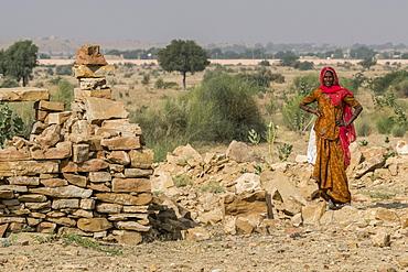 An Indian woman standing in Thar Desert, Jaisalmer, Rajasthan, India