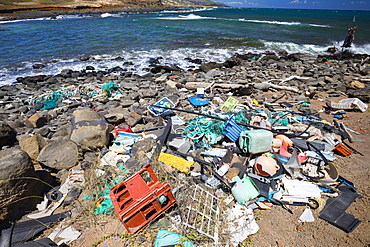 Much of the north side of the island of Molokai in inaccessible. Trade winds blow onshore regularly bringing with them piles of plastic that has been floating around the Pacific Ocean for years and years, Molokai, Hawaii, United States of America