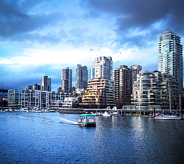 Sunset over Yaletown with boats in the harbour, Vancouver, British Columbia, Canada
