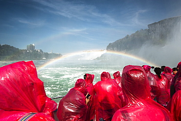 Tourists on a boat wearing red ponchos and viewing Niagara Falls, Niagara Fall, Ontario, Canada
