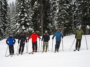 Skiers standing in a row, Sun Peaks Resort, Kamloops, British Columbia, Canada