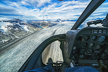 Flying in a helicopter over the icefields in Kluane National Park, near Haines Junction, Yukon, Canada