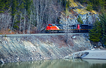 Canadian National Railway train traveling beside a lake, Terrace, British Columbia, Canada