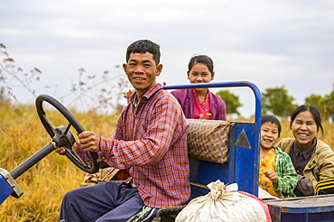 Family riding together in truck through farm fields, Taungyii, Shan State, Myanmar