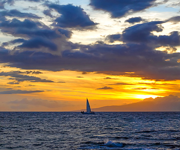 Sailboat in the ocean off the coast of Kamaole One and Two beaches, Kamaole Beach Park, Kihei, Maui, Hawaii, United States of America