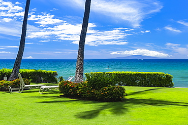Lounge chairs on lush grass with a view, Kamaole One and Two beaches, Kamaole Beach Park, Kihei, Maui, Hawaii, United States of America