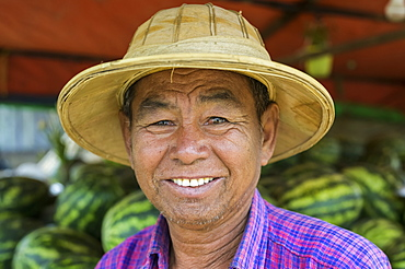 Portrait of a man selling watermelons, Taungyii, Shan State, Myanmar