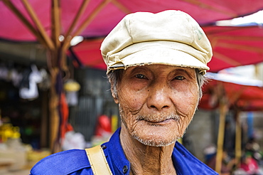 Portrait of a senior man wearing a hat at the market, Taungyii, Shan State, Myanmar