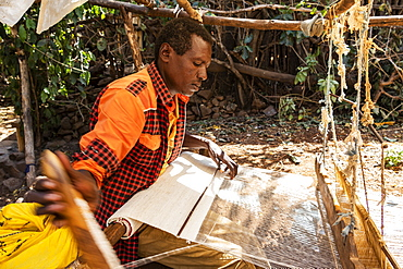 Konso man weaving cloth on his loom, Karat-Konso, Southern Nations Nationalities and Peoples' Region, Ethiopia