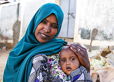 Ethiopian woman holding a boy in Harar Jugol, the Fortified Historic Town, Harar, Harari Region, Ethiopia