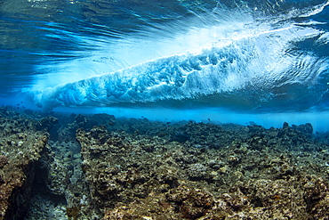 Surf crashes on the reef off the island of Yap in Micronesia. Underwater view of a wave breaking, Yap, Federated States of Micronesia