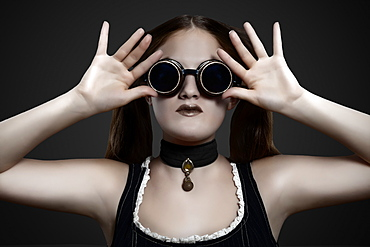 Glamour shot of girl in steampunk outfit on a black background, Toronto, Ontario, Canada