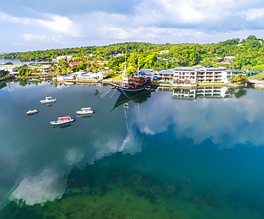 View from the water of the Manta Ray Bay Resort and it's floating restaurant 'The Mnuw', Yap, Micronesia