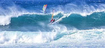 Two windsurfers ride the breaking waves, Kihei, Maui, Hawaii, United States of America