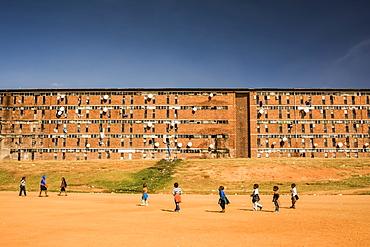Children playing outside a workers' hostel in Alexandra Township, Johannesburg, Gauteng, South Africa