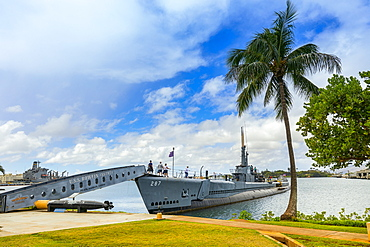 Torpedo display and tourists exploring a submarine at Pearl Harbour, Oahu, Hawaii, United States of America