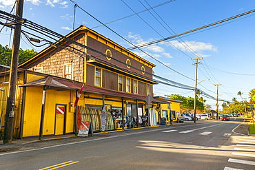Surf town of Haleiwa, with a bright yellow building renting surfboards, Haleiwa, Oahu, Hawaii, United States of America