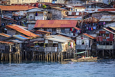 Poor district slums with wooden houses over water, Cebu city, Philippines