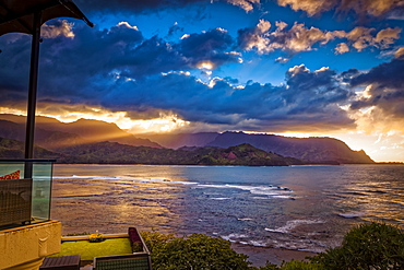 Golden sunset at Hanalei Bay, viewed from The St. Regis Princeville Resort, Princeville, Kauai, Hawaii, United States of America