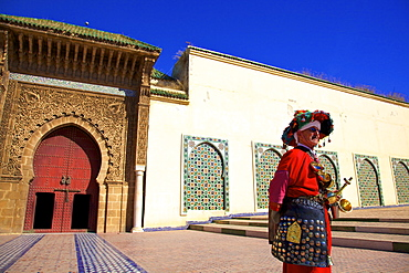 Water Carrier in from of Mausoleum of Moulay Ismail, Meknes, Morocco, North Africa, Africa