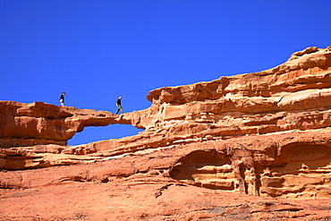 Tourists climbing at Wadi Rum, Jordan, Middle East