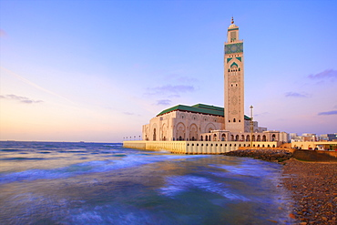 Exterior of Hassan ll Mosque and coastline at dusk, Casablanca, Morocco, North Africa, Africa