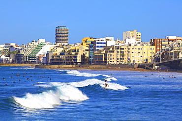 Surfers on Playa de las Canteras Beach, Santa Catalina District, Las Palmas de Gran Canaria, Gran Canaria, Canary Islands, Spain, Atlantic Ocean, Europe