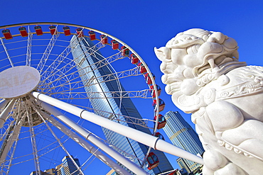 Chinese Guardian Lion with The Hong Kong Observation Wheel and IFC Building, Hong Kong, China, Asia