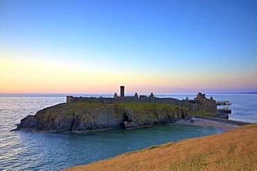 Peel Castle at sunset, St. Patrick's Isle, Isle of Man, Europe
