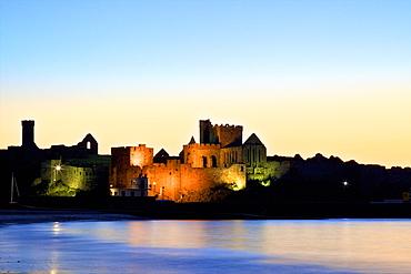 Peel Castle at dusk, St. Patrick's Isle, Isle of Man, Europe