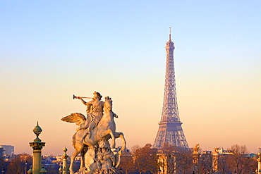 Eiffel Tower from Place de La Concorde with statue in foreground, Paris, France, Europe