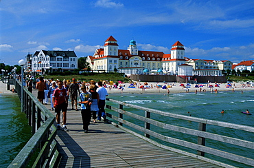 Sea bridge with beach and casino of the health resort Binz, Isle of Ruegen, Mecklenburg-Western Pommerania, Germany