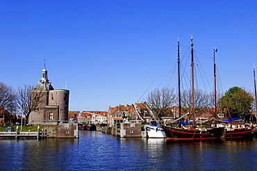 Defence tower 'Dromedaris' and ships in harbour, Enkhuizen, Netherlands