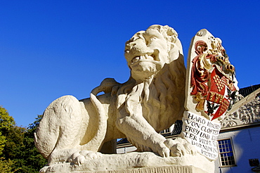 Lion sculpture at the moated castle Norderburg, Dornum, Lower Saxony, Germany