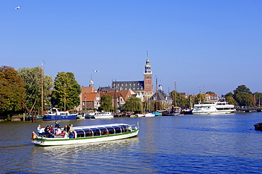 Pleasure boat, town hall and harbour, Leer, Lower Saxony, Germany