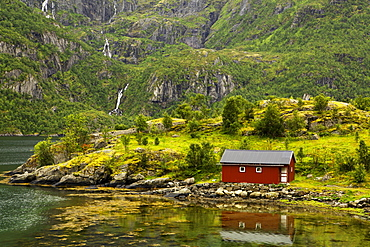 Cottage at fjord, near Laupstad, Lofotes, Norway
