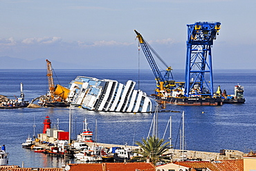 Recovery work at sinking cruise liner, Costa Concordia, at harbour of Island Giglio, Tuscany, Italy / cruise ship, Isola del Giglio