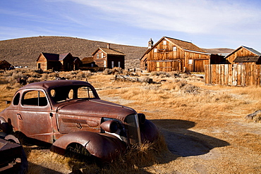 Wrecked car, car wreck, abandoned 1937 Chevrolet coupe, ghost town, mining town, Bodie State Historic Park, Bodie, California, USA