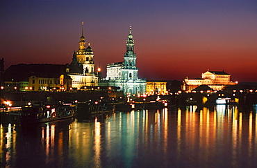 View on old part of Dresden at night over Elbe river, Bruhl Terrace with castle, Court church and Semper opera house, Saxony, Germany / Bruhlsche Terasse
