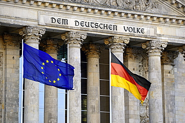 Flags of European Union and Germany, main gable of Reichstag Building, Bundestag, Berlin, Germany