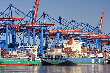 Container ships and Feeder on HHLA Container-terminal, Hamburg, Germany, Europe