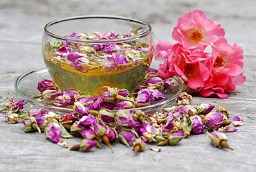 cup of rose tea, dried rose buds, rose blossom tea