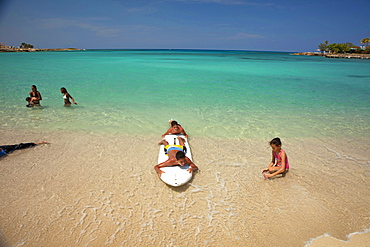 kids with surf board at Bacuranao Beach, Playas del este, Havana, Cuba, Carribean