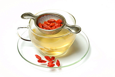 Cup of Goji tea, tea strainer / (Lycium barbarum)