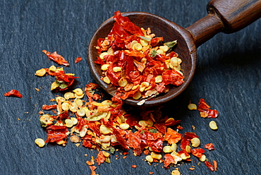 Dried crushed Chili pepper / wooden spoon, Piri-Piri