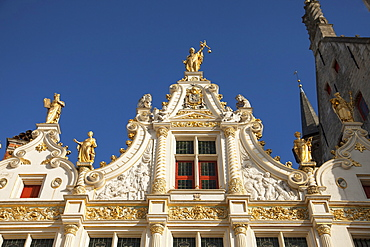 Justitia on Chancellory, decorated with gold, historic center of Bruges, Belgium