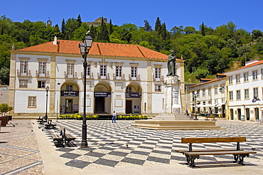 Town Hall in praca da Reublica and templar castle of Christ at background, Tomar, Santarem distric, Ribatejo, Portugal